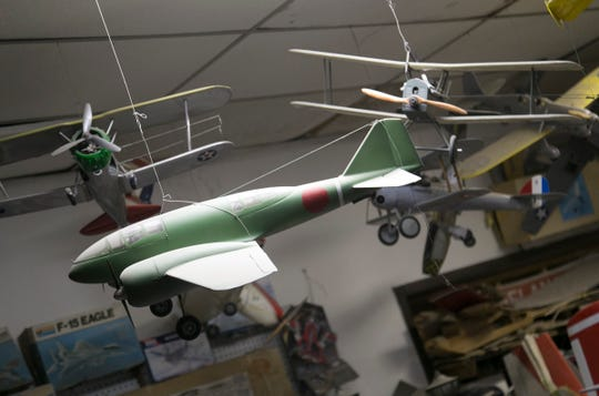 Model and radio controlled airplanes hang above the work place of Lexington businessman Timothy Corwin.