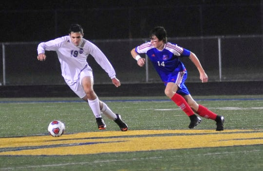 Lexington's Sam Elgin kicks the ball while playing against Bay Village at Wooster on Wednesday.