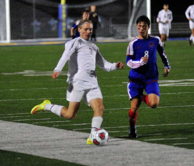 Lexington's Camden Geottel kicks the ball while playing against Bay Village at Wooster on Wednesday.