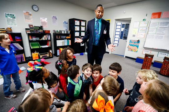 Oak Elementary music teacher Anthony Q. Richardson (top) instructs first-graders during class. Bartlett City Schools was named 2018's top workplace among large Memphis-area employers.