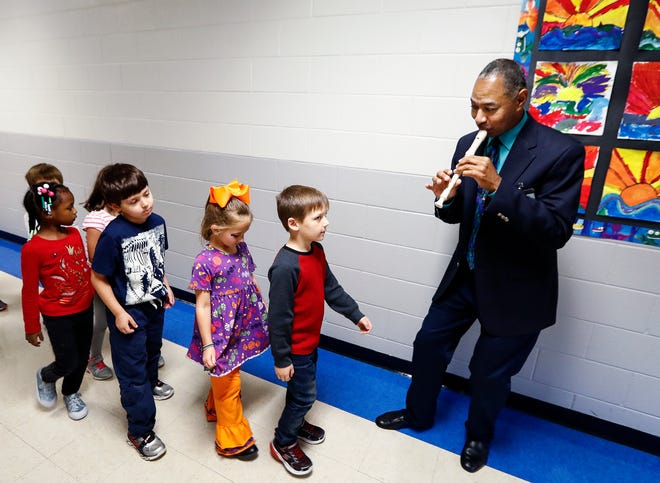 Oak Elementary music teacher Anthony Q. Richardson (top) instructs first-graders during class. Bartlett City Schools was named 2018's top workplace among Memphis-area employers.