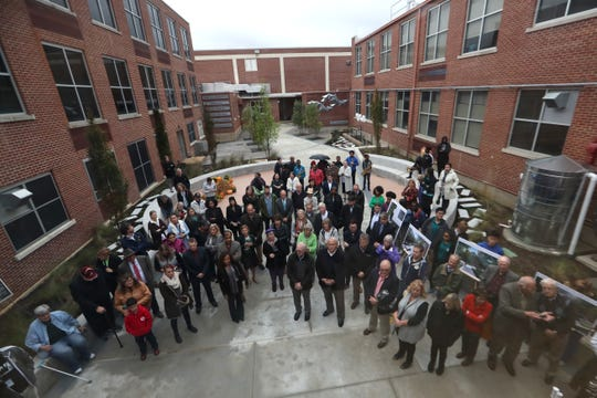 Nearly 100 people gather at White Station High Thursday for a ribbon cutting ceremony honoring the completion of a privately funded courtyard, spearheaded by parents and alumni.