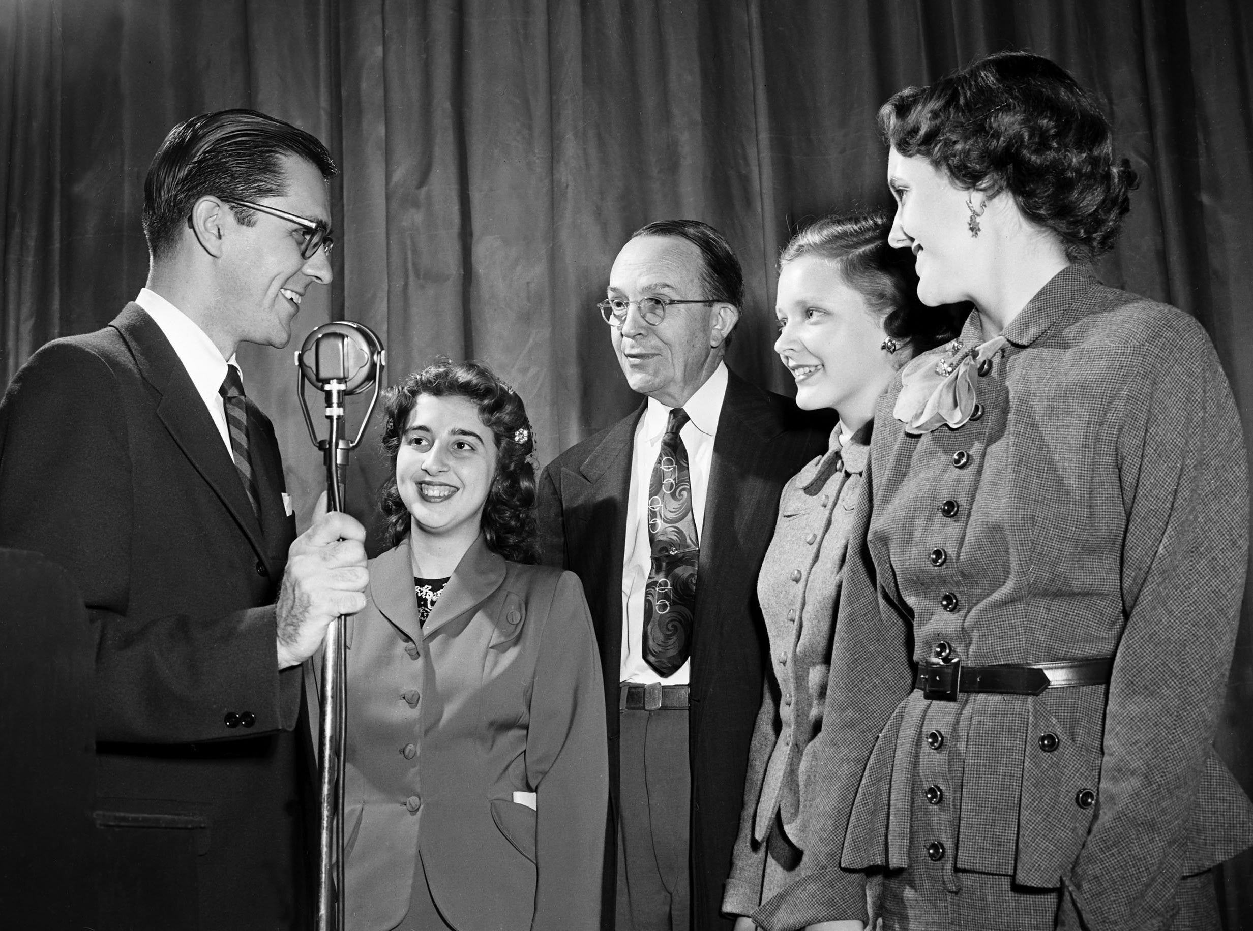 Grouped about Charles Corddry Jr. (Left), aviation writer in the Washington Bureau of the United Press, after his King Cotton Luncheon talk on 3 Nov 1952, are Margaret Rose Pace (Second Left) of St. Agnes, W.C. Teague (Center), editorial writer of The Commercial Appeal who served as toastmaster at the luncheon, Mary Walton Glass (Second Right) of East high and Sue Hall (Right) of Miss Hutchison's School.