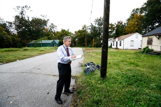 Steve Shular is Mayor Jim Strickland's new special assistant for neighborhood concerns, surveys vacant homes on Hale Ave. in Binghampton.
