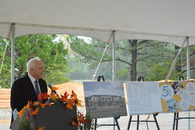 Bob May, Avenida Partners LLC founder, speaks to a small crowd. Avenida broke ground in Germantown Thursday.
