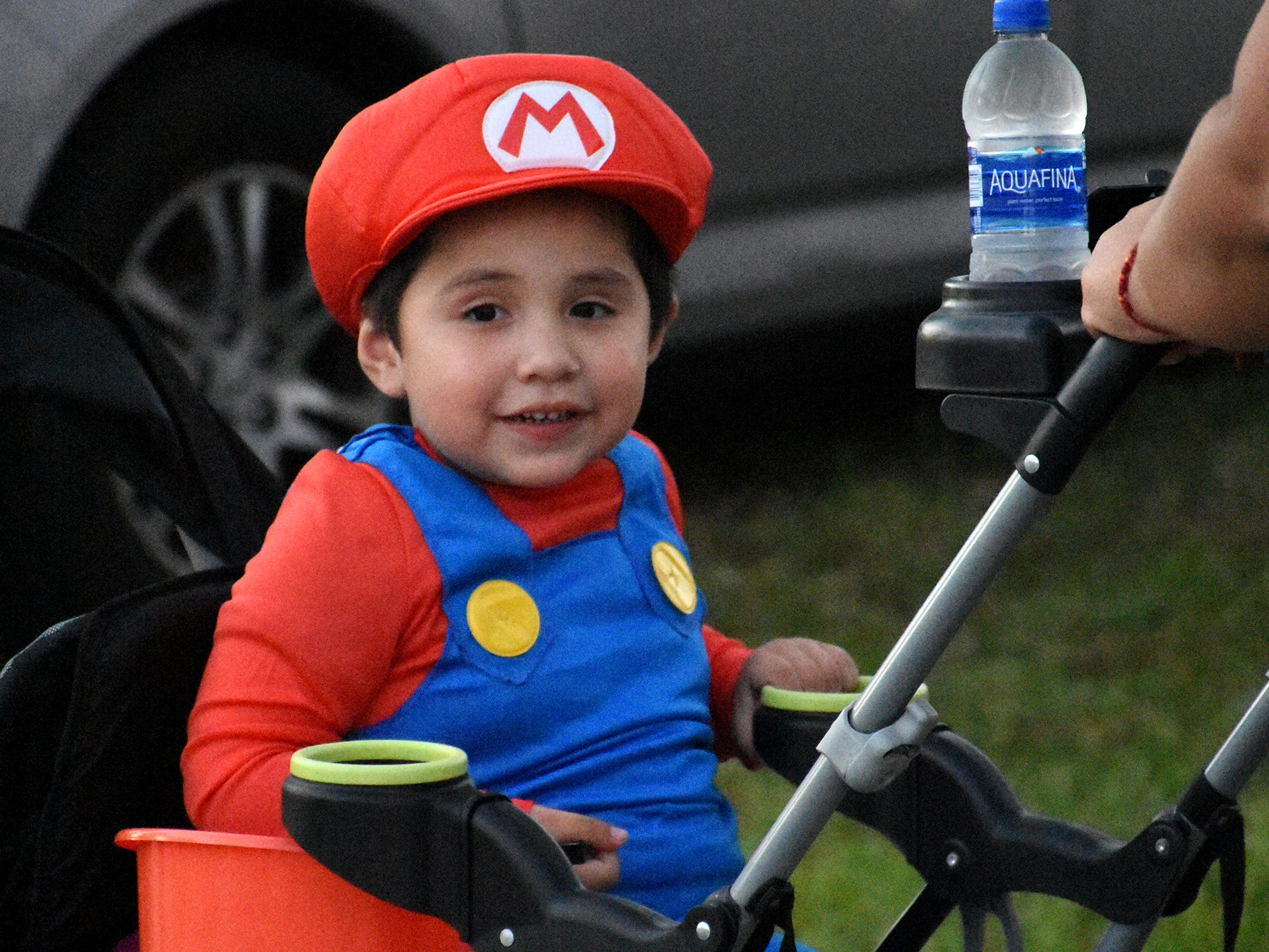 Matthew Sanchez, 5, as Mario. Wednesday evening, in a decades-old tradition, the streets around Tommie Barfield Elementary turned into a trick or treatin' block party.