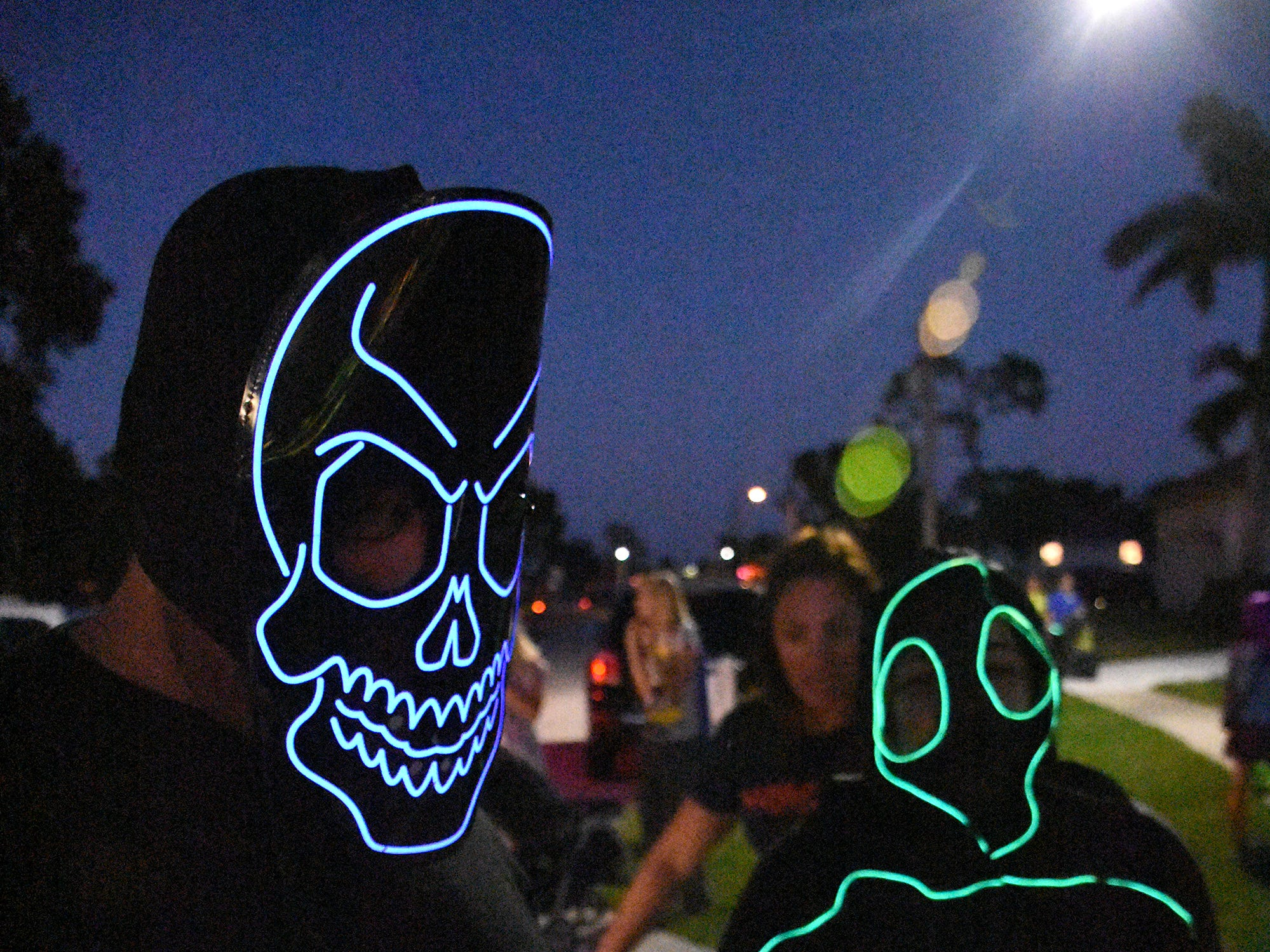 Art and Lisa Faradi show off their hi-tech lit up costumes. Wednesday evening, in a decades-old tradition, the streets around Tommie Barfield Elementary turned into a trick or treatin' block party.