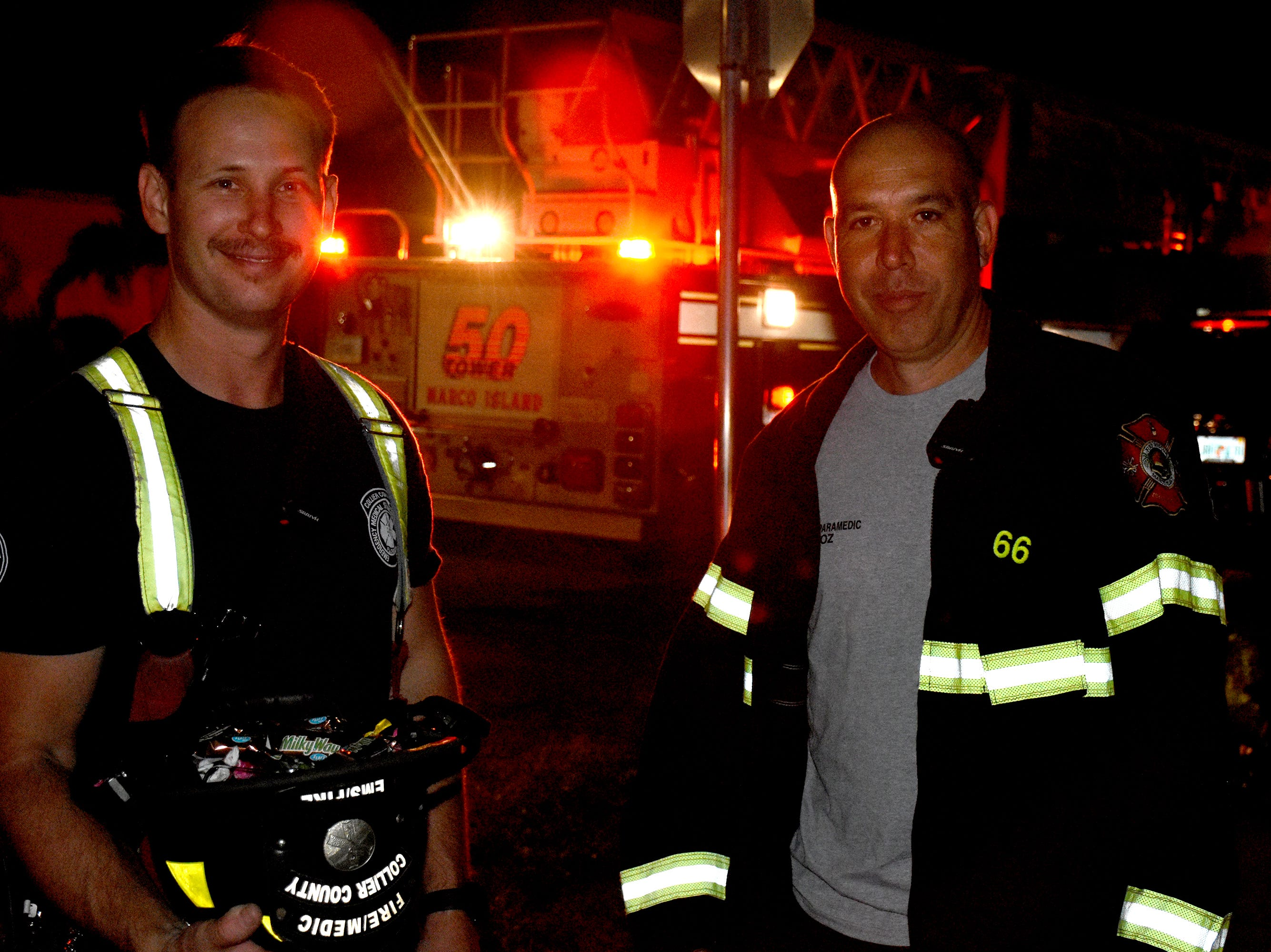 Firefighters Kurt Peterson, left, and Albert Muñoz sport convincing costumes. Wednesday evening, in a decades-old tradition, the streets around Tommie Barfield Elementary turned into a trick or treatin' block party.