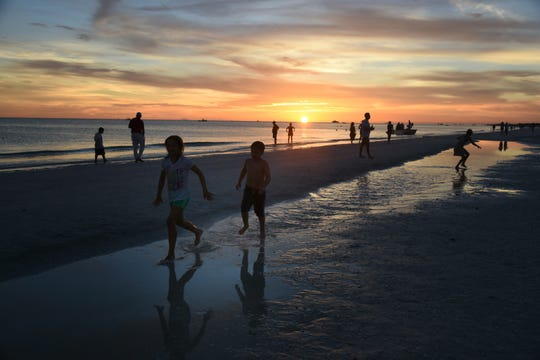 Kids play in a pool at the water's edge in this file photo. Collier County will begin a million dollar-plus reshaping of the beach along Marco Island in the early months of 2019.