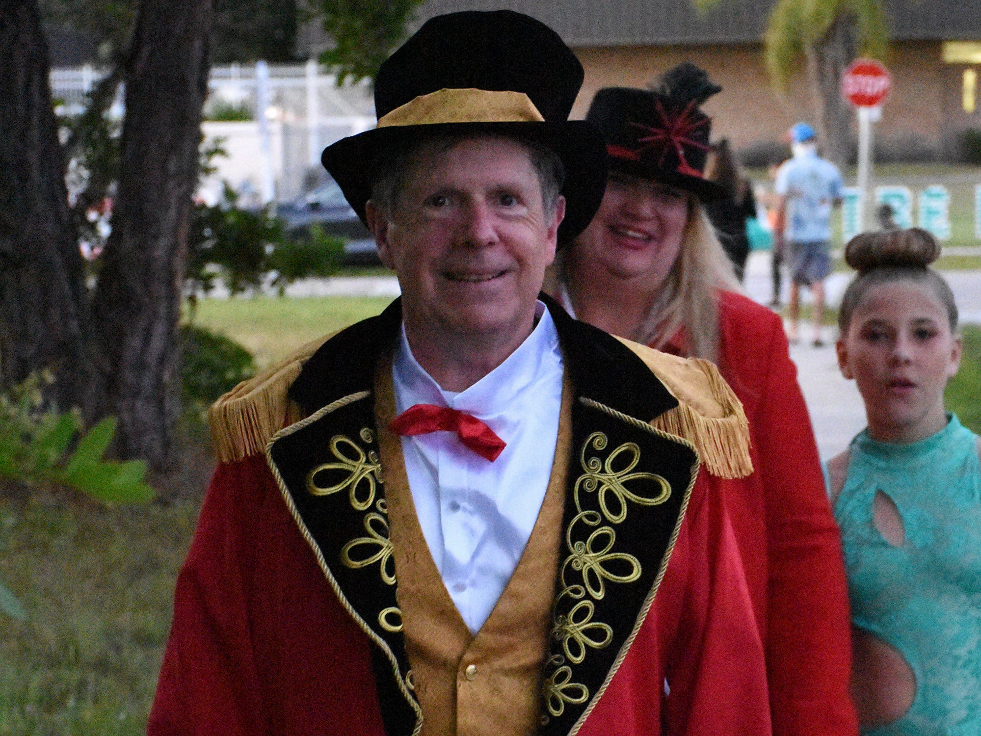 """Bill Morris as """"The Greatest Showman,"""" with wife Peggy and some of his personal family circus. Wednesday evening, in a decades-old tradition, the streets around Tommie Barfield Elementary turned into a trick or treatin' block party."""