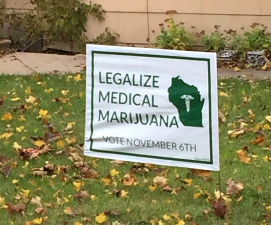A homeowner in the 2500 block of South Delaware Avenue in Milwaukee displays a political yard sign in support of legalizing medical marijuana. Sixteen counties and two cities placed advisory referendums on medical and recreational use of marijuana on general election ballots in November 2018.