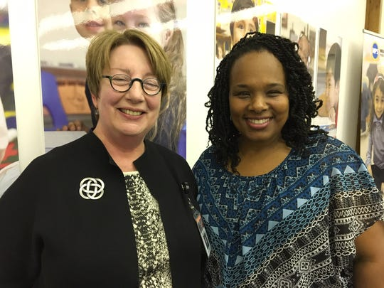 Dea Wright (right), director of the City of Milwaukee's new Office of Early Childhood Initiatives, which will be housed in the Milwaukee County Library. The library, led by Director Paula Kiely (left), is a partner in a new citywide effort to enhance early childhood education for low-income children.