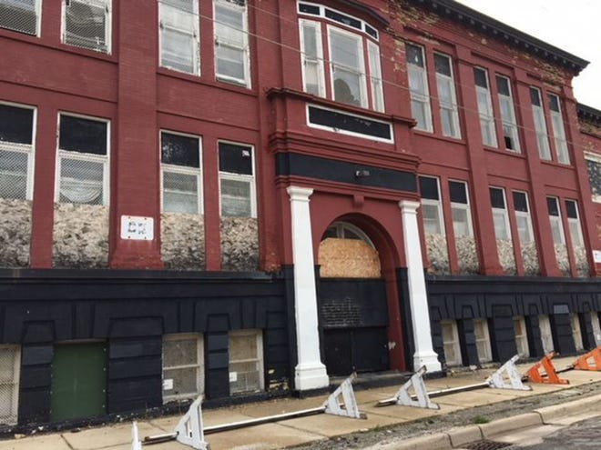 The historic former William McKinley School would be converted into affordable apartments under a new proposal.