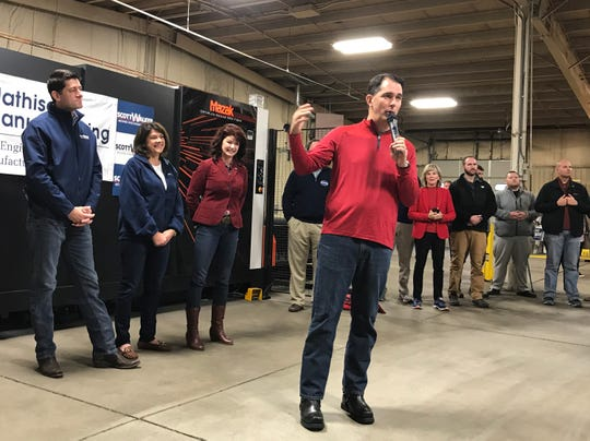 Gov. Scott Walker appears in Waukesha Thursday at the beginning of his bus tour to drum up votes in Tuesday's election. Behind him are House Speaker Paul Ryan, state Sen. Leah Vukmir (middle), who is running against Democratic U.S. Sen. Tammy Baldwin, and Lt. Gov. Rebecca Kleefisch.