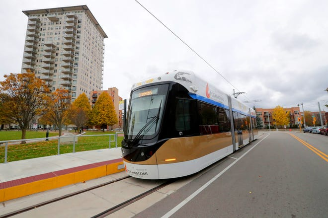 The Milwaukee Streetcar stops on East Ogden Avenue at the Burns Commons stop across from the Breakwater Condominiums (left) on Thursday, November 1, 2018.