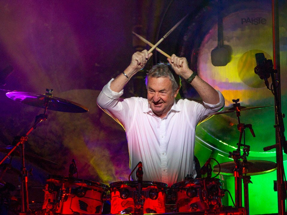 """This Sept. 23, 2018 photo released by Jill Furmanovsky shows Pink Floyd drummer Nick Mason performing with Nick Mason's Saucerful of Secrets band in Portsmouth, England.  Mason is planning to tour North America next year to perform some classic Floyd songs. His band will be jamming to pre-""""Dark Side of the Moon"""" material. (Jill Furmanovsky/www.rockarchive.com via AP) ORG XMIT: NYET100"""