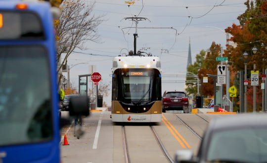 The Milwaukee streetcar heads east down East Ogden Avenue approaching North Farwell Avenue on Thursday.