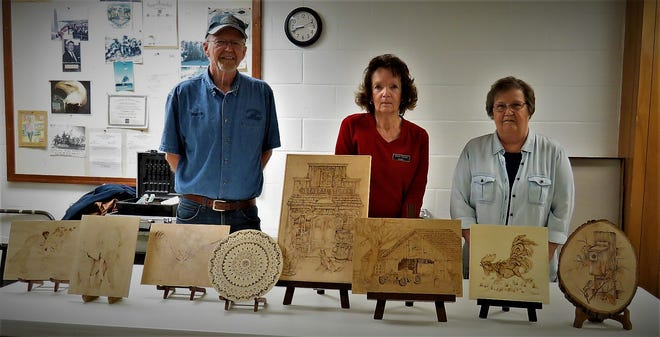 Dave McConkey (from left), Diane Gum and Myrna McCurley are the North Arkansas Woodcarvers' Club featured carvers. The trio became involved in Pyrographyis and are instructing other carvers in the skill.
