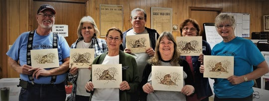Students from a recent wood burning class are shown with their projects. Pictured are: (first row, from left) Pamala Frost, Donna Gulley, (second row) Al Baker, Sue Harris, Bob Shaffer, Linda Lopin and Sandra Lord.