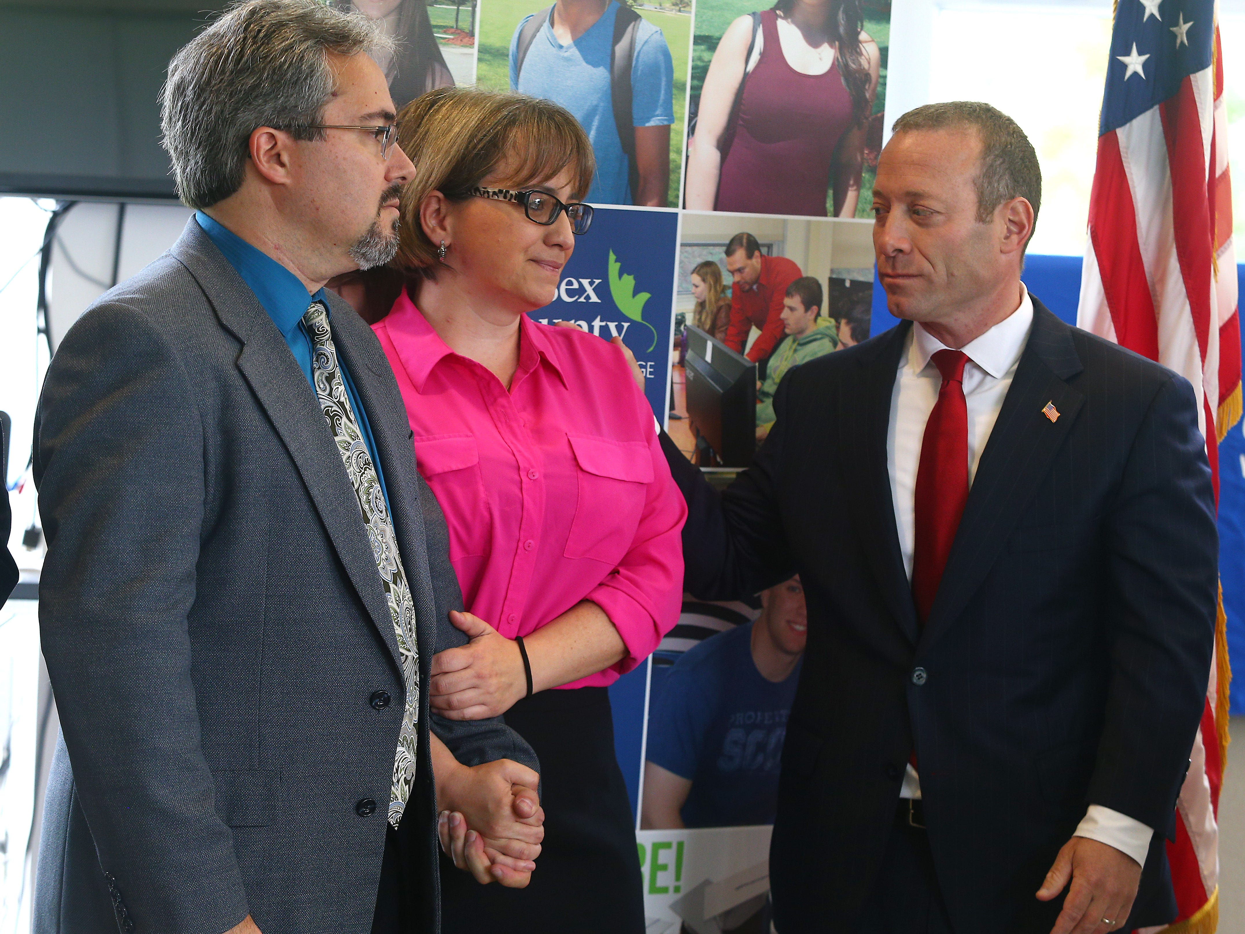 Congressman Josh Gottheimer, r, comforts Colleen Murch as Adam Stolarsky looks on during the Stand United Against Hate rally at the Performing Arts Center of Sussex County Community College. Hampton Township residents Murch and Stolarsky found vulgar graffiti sprayed on the road in front of their residence. This followed an incident last weekend in which a vandal spray-painted a swastika on their garage and a campaign sign for Rep. Josh Gottheimer. October 2, 2018, Newton, NJ