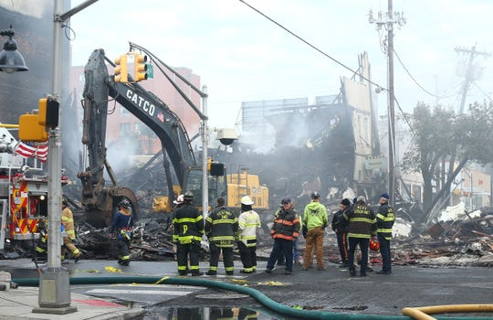 The aftermath of a devastating fire on North Warren Street in Dover that collapsed multiple businesses in a fast-moving, seven-alarm blaze that officials say started in the basement of Barry's restaurant. The fire then spread throughout the building and to others nearby that contained businesses and apartments Displacing about 100 people from their homes. October 23, 2018, Dover, NJ