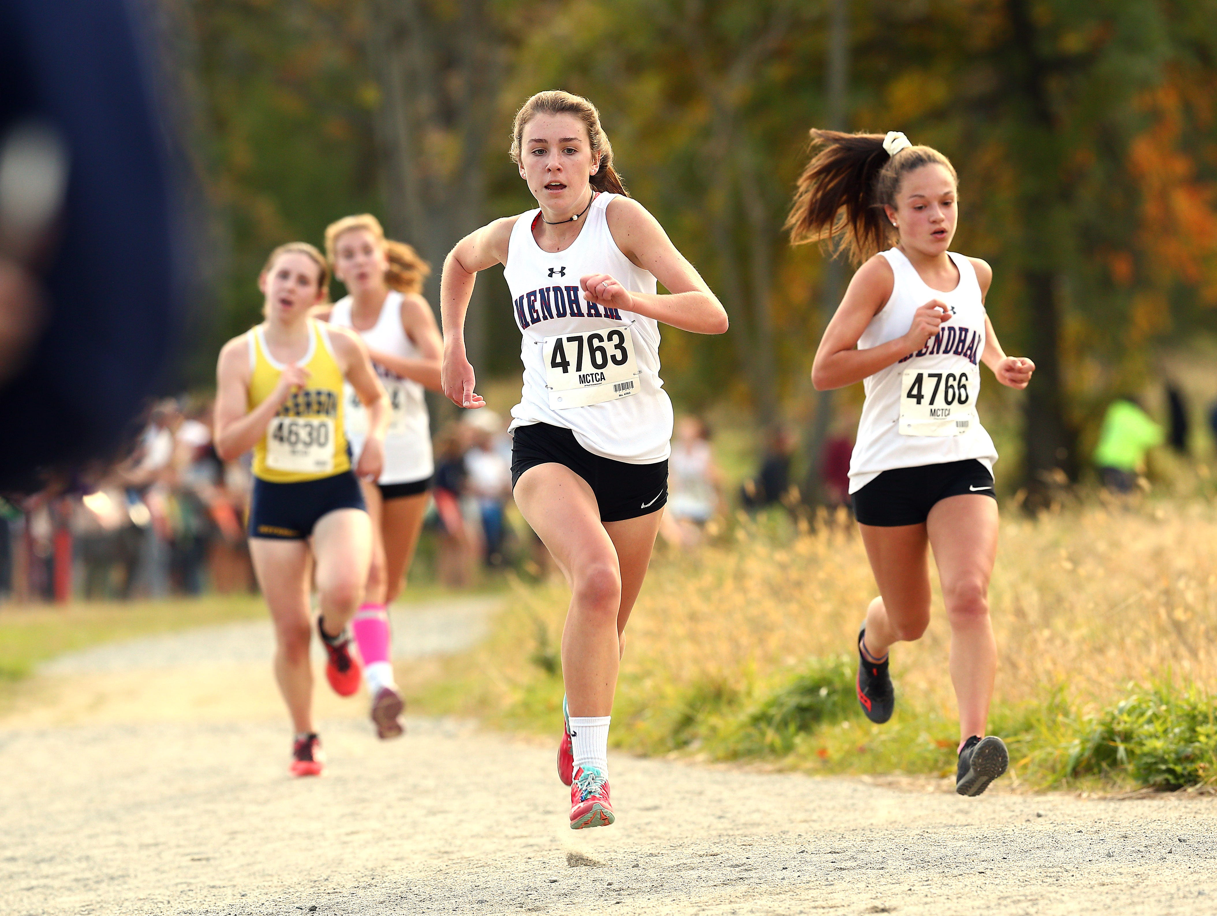 Mendham's Megan Timoney and Grace Vives come into the finish during the Morris County girls cross country championships at Central Park of Morris County. October 23, 2018, Morris Plains, NJ