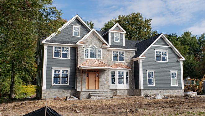 This 15 room manor home in Florham Park has five bedrooms, a two-car attached garage, a master suite with a sitting room and private bath and a gourmet kitchen. Offered at $1.599 million.