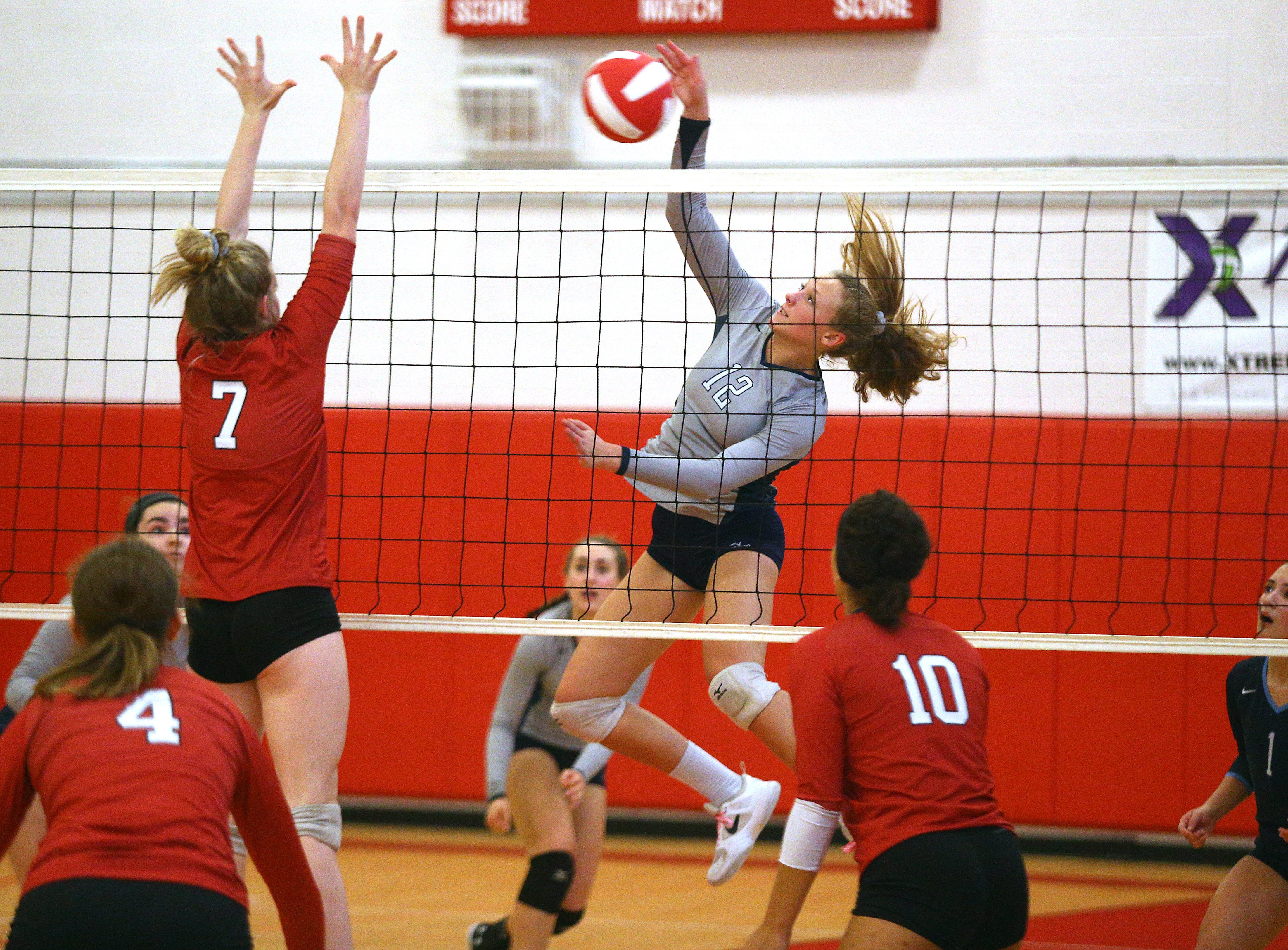 West Morris Central's Olivia Falzarano goes for a kill vs. Mount Olive during their volleyball matchup.  October 4, 2018, Mount Olive, NJ