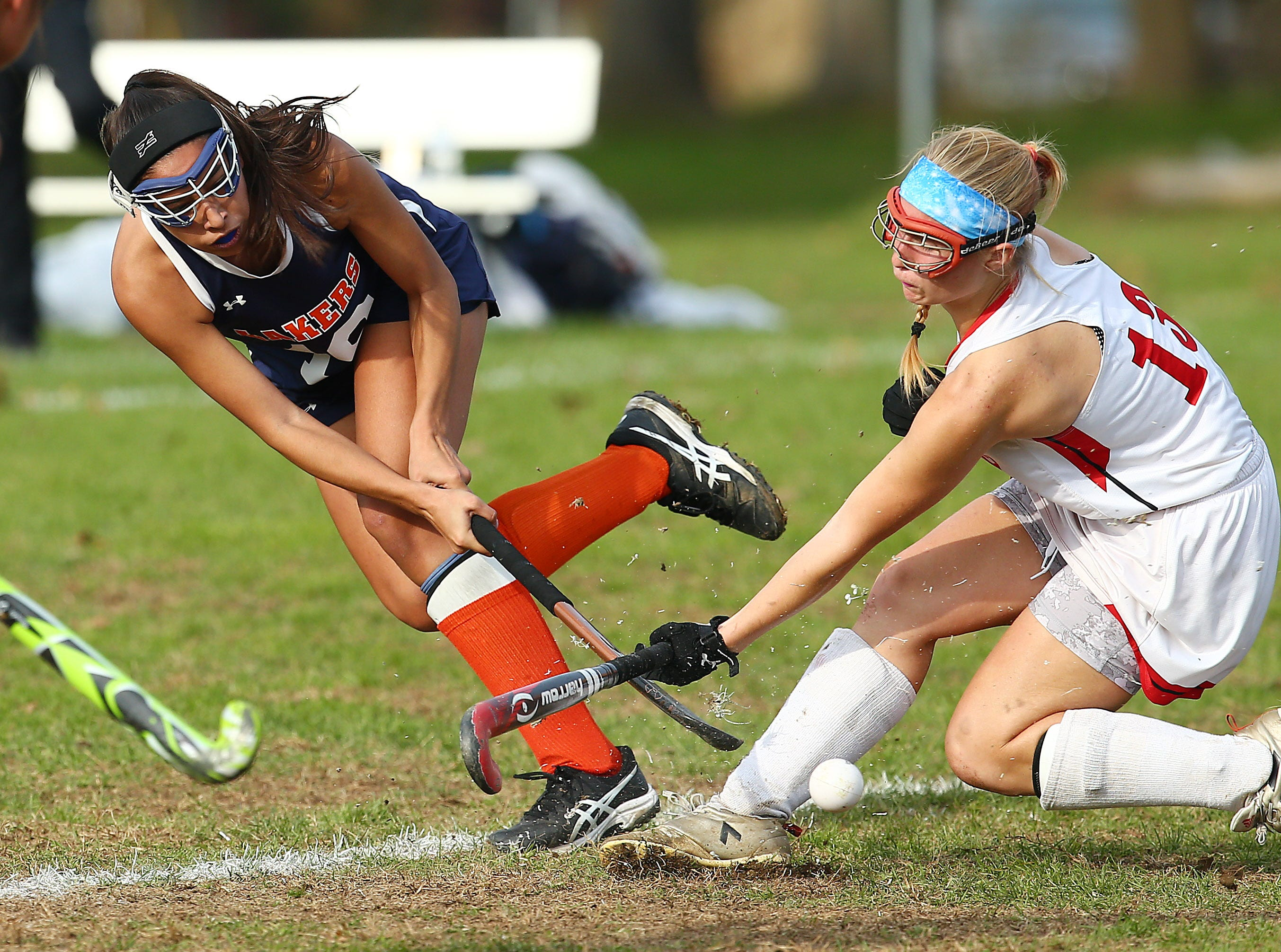 Mountain Lakes Macara Desai takes a shot on goal at Belvidere's Melanie Clark defends during their NJSIAA North 1 Group I field hockey semifinal. October 31, 2018, Belvidere, NJ