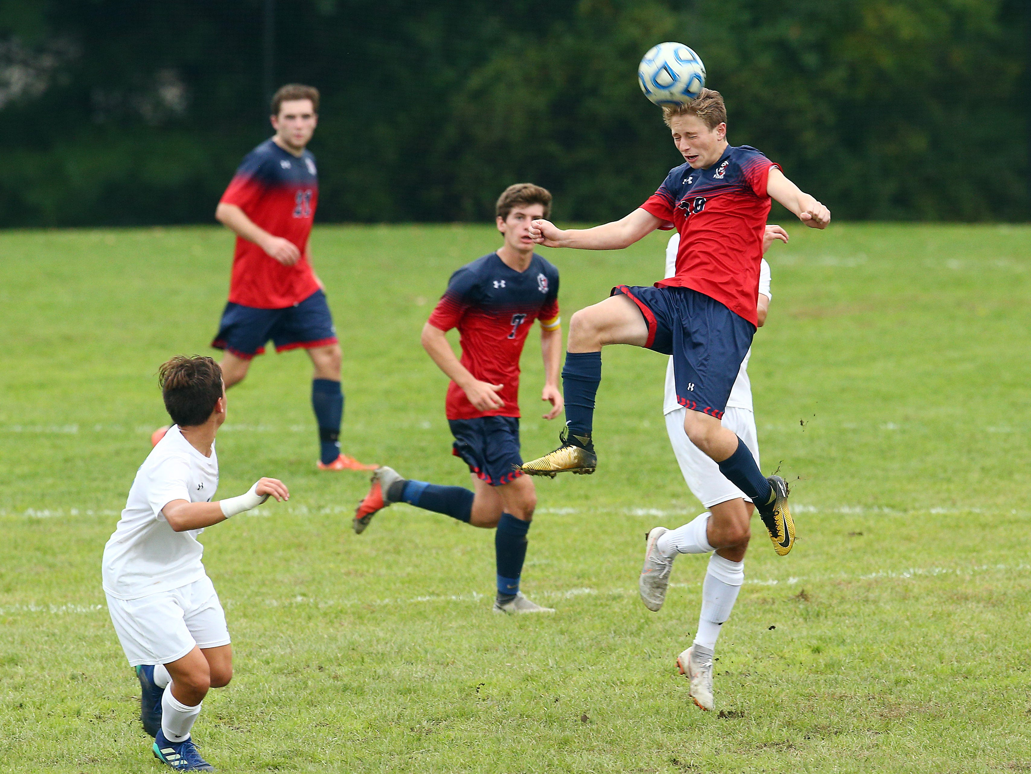 Mendham's Zach Skuraton heads the ball vs. Chatham during their NJAC-American boys soccer match. October 2, 2018, Mendham, NJ