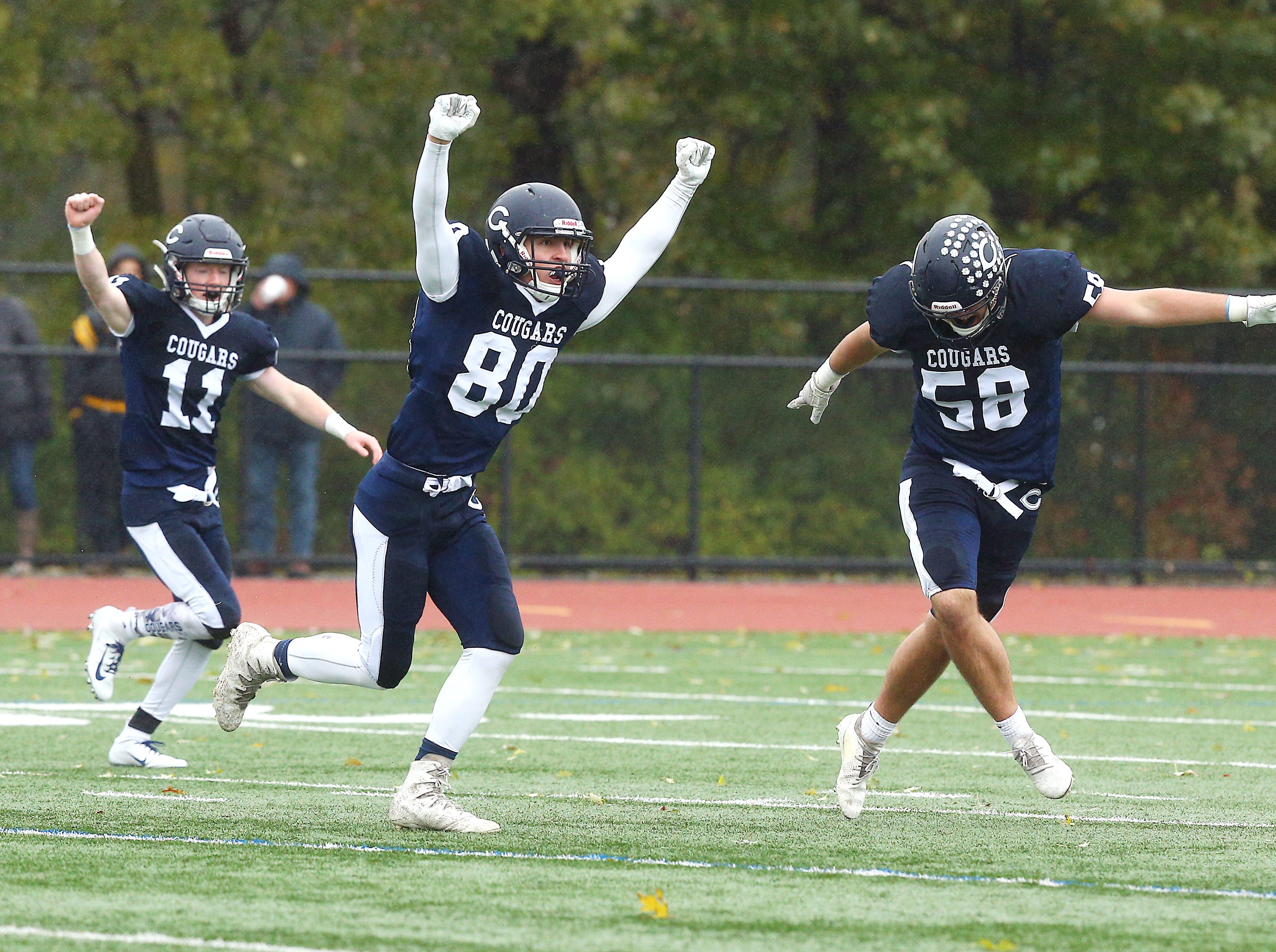 Chatham defense celebrates stopping Hanover Park on 4th and short during their Saturday SFC American White football game. October 27, 2018, Chatham, NJ