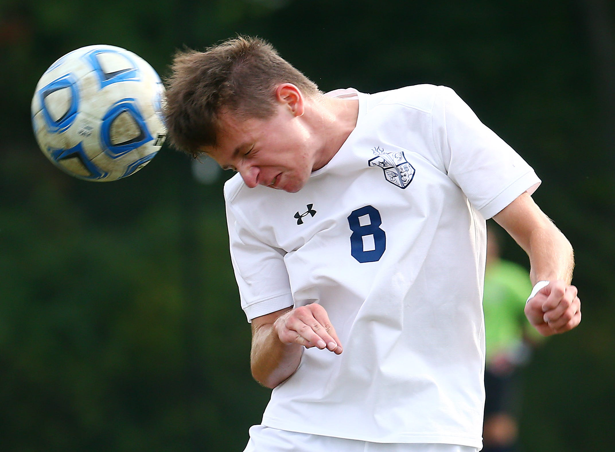Chatham's Tyler Scmitter heads the ball vs. Mendham during their NJAC-American boys soccer match. October 2, 2018, Mendham, NJ