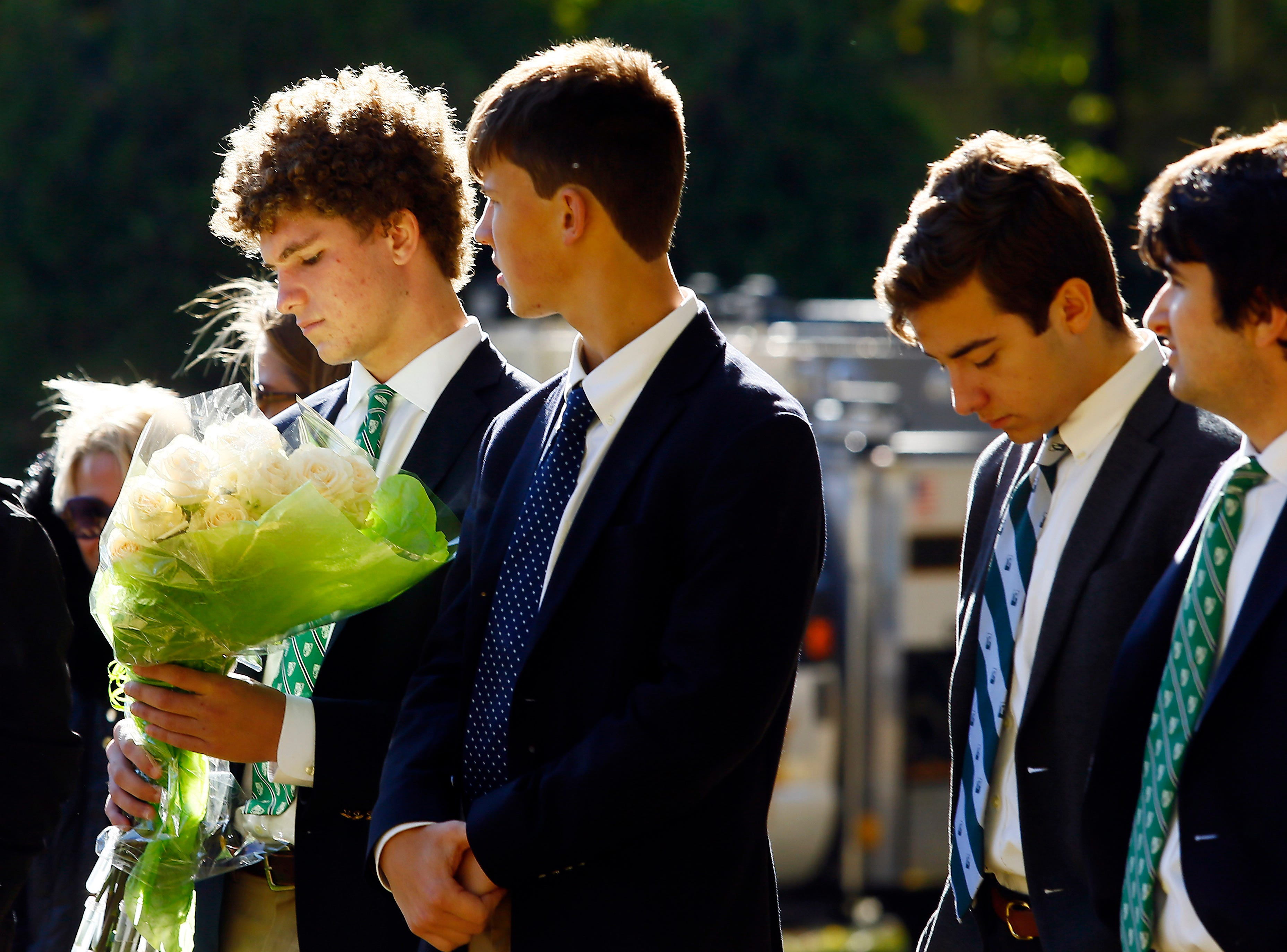 Delbarton junior Jack Readlinger, l, joined classmates during a graveside service and blessing at Orchard Street Cemetery in Dover gathering to bless the grave for baby Anthony Mary, whom they so-named after he was abandoned and found deceased at a recycling center in Mine Hill. October 30, 2018, Dover, NJ