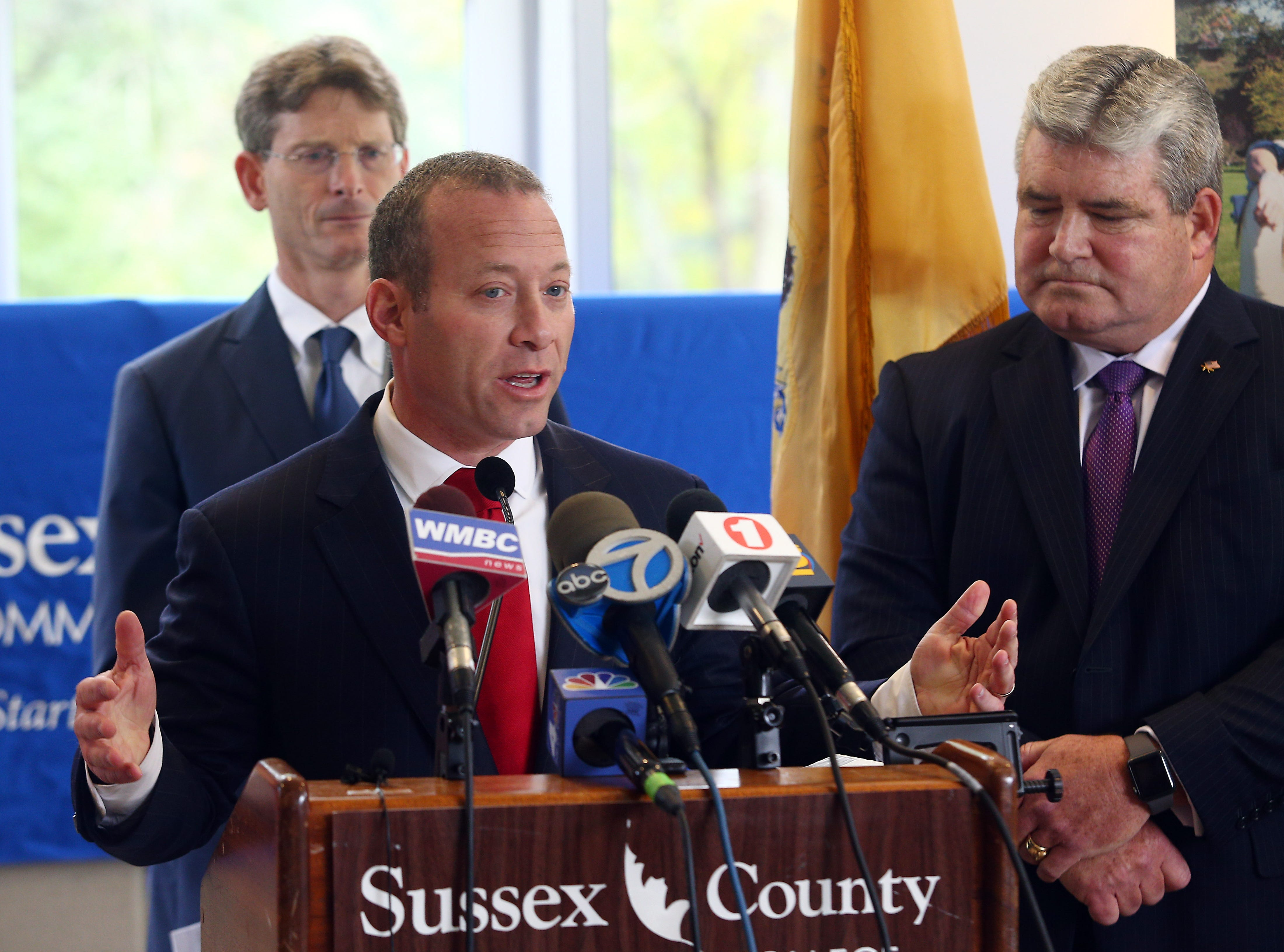 Congressman Josh Gottheimer speaks during the Stand United Against Hate rally at the Performing Arts Center of Sussex County Community College as Senator Steven Oroho looks on. Hampton Township residents Colleen Murch and Adam Stolarsky found vulgar graffiti sprayed on the road in front of their residence. This followed an incident last weekend in which a vandal spray-painted a swastika on their garage and a campaign sign for Rep. Josh Gottheimer. October 2, 2018, Newton, NJ