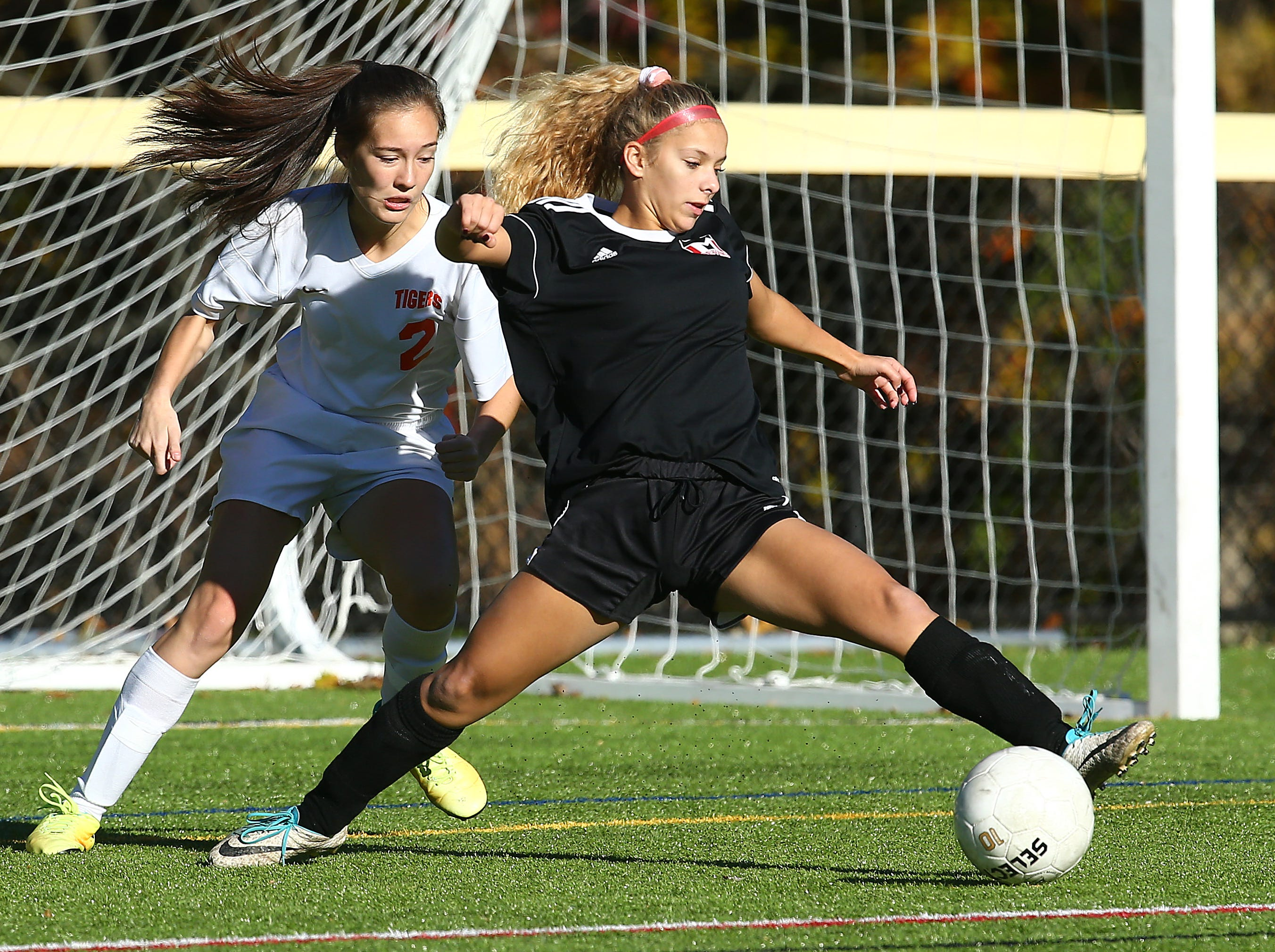 Morris Tech's Julia Gronda tries to control the ball in front of the Dover goal as Manuela Ospina defends during their NJSIAA North 2 Group II opening round girls soccer match at Veterans Memorial Park. October 30, 2018, Denville, NJ