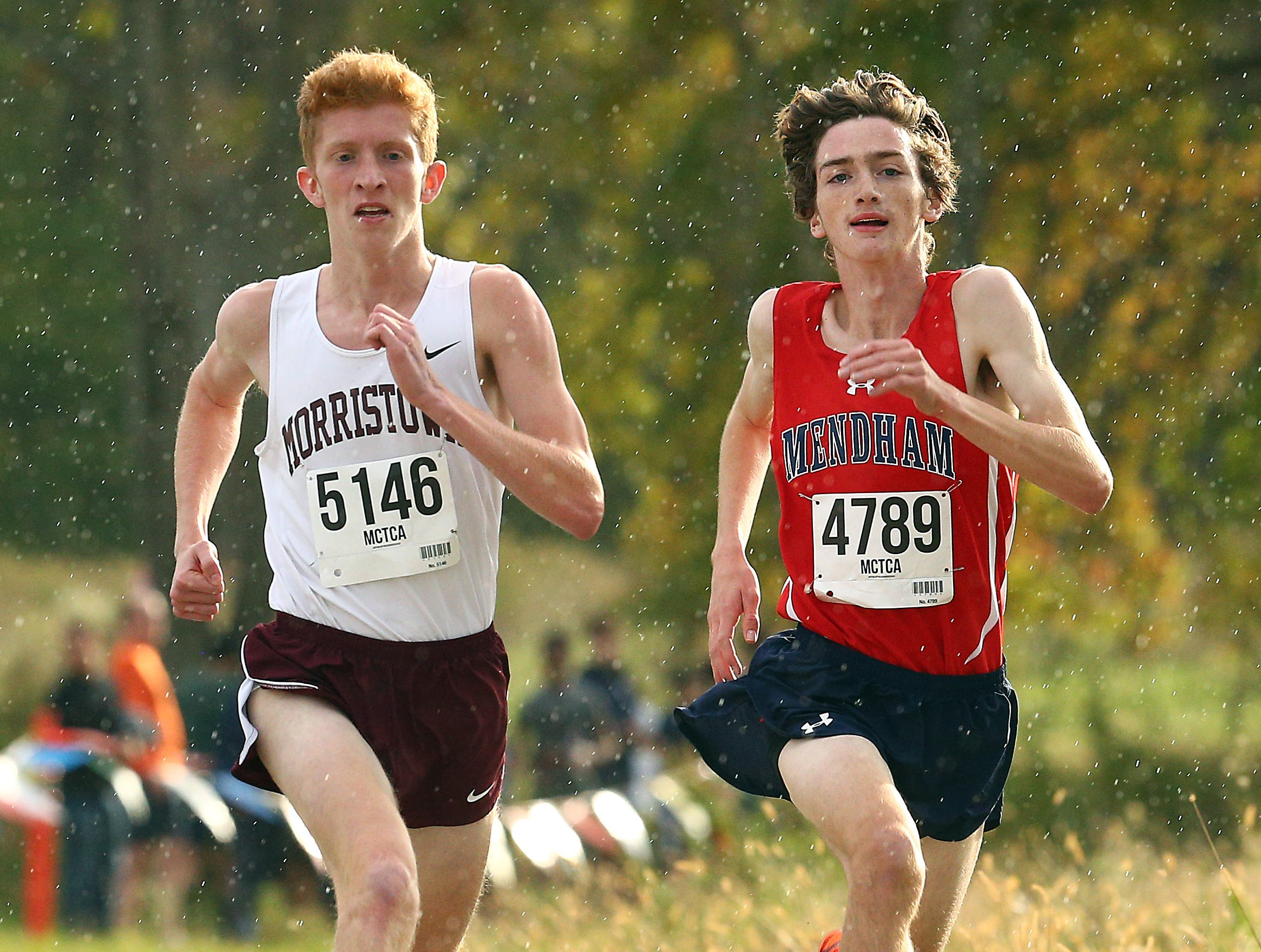 Morristown's Patrick Mullen and Mendham's Jack Jennings battle to the finish during the Morris County boys cross country championships at  Central Park of Morris County. October 23, 2018, Morris Plains, NJ