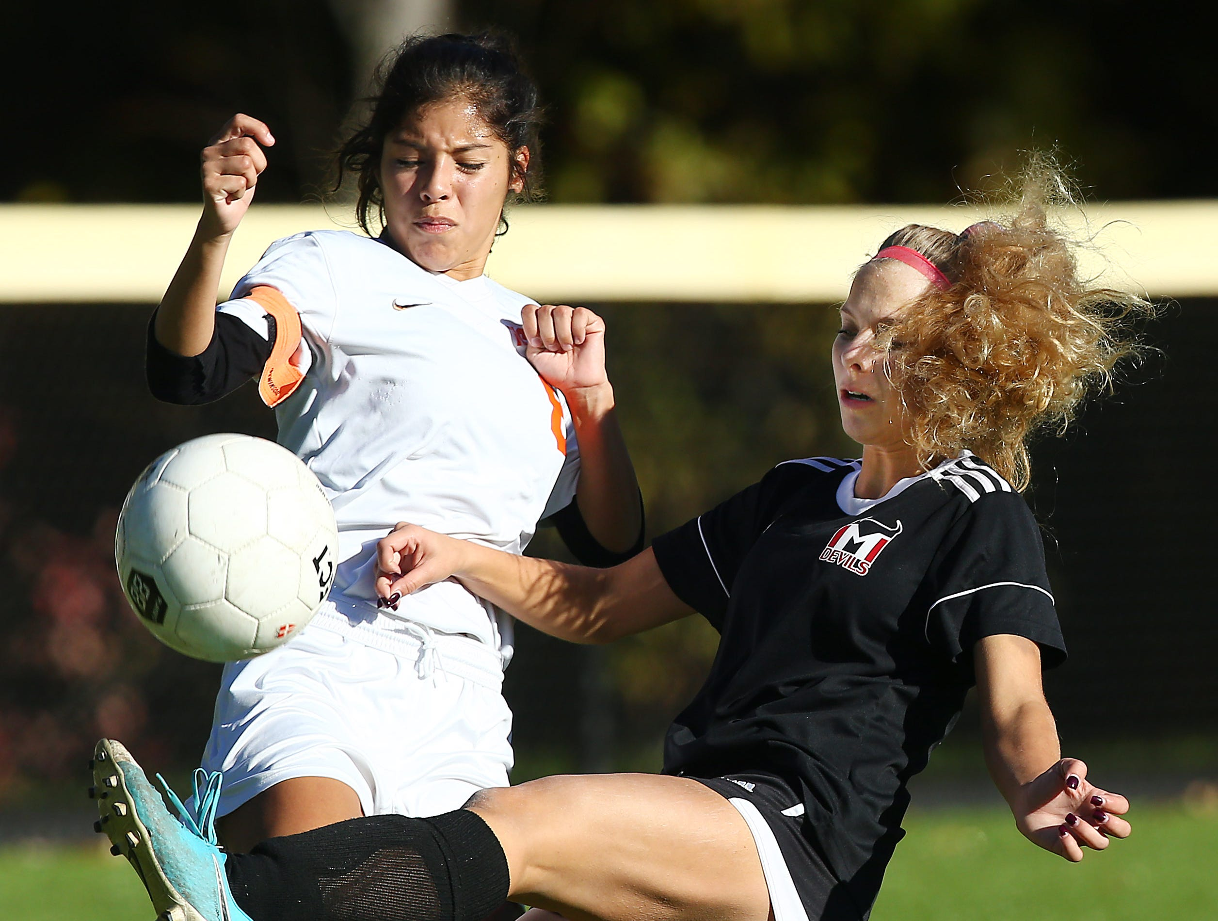 Morris Tech's Julia Gronda controls the ball vs. Dover defender Edith Rubio during their NJSIAA North 2 Group II opening round girls soccer match at Veterans Memorial Park. October 30, 2018, Denville, NJ