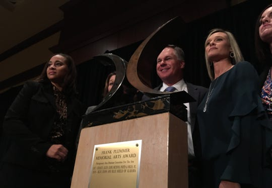 Representatives from Blue Cross and Blue Shield of Alabama accept the Frank Plummer Memorial Arts Award on Thursday in Montgomery.