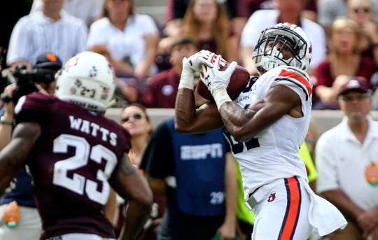 Auburn wide receiver Darius Slayton (81) makes a reception during the third quarter against Texas A&M on Nov. 4, 2017, in College Station, TX.