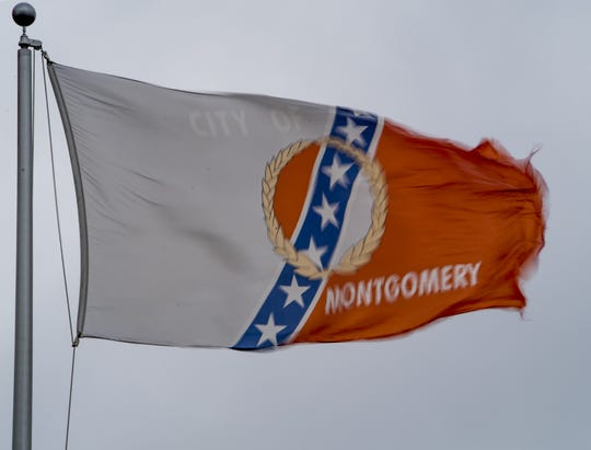 The wind whips the City of Montgomery flag as the remnants of Irma arrive in Montgomery, Ala. on Monday afternoon September 11, 2017.