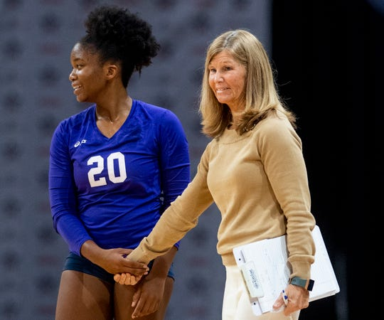 Montgomery Academy's Grace Jackson holds  coach Julie Gordon's hand in the AHSAA State Volleyball Finals in Birmingham, Ala., on Thursday November 1, 2018.