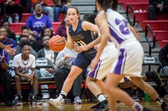 FILE -- Delta's Kassidy Dishman dribbles past a Central defender in the 2018-19 season opener.