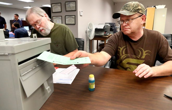 Chris Nichols drops his paper ballot into the election box while the voting machines were down in Rutherford County the last day of early voting on, Thursday Nov. 1, 2018.