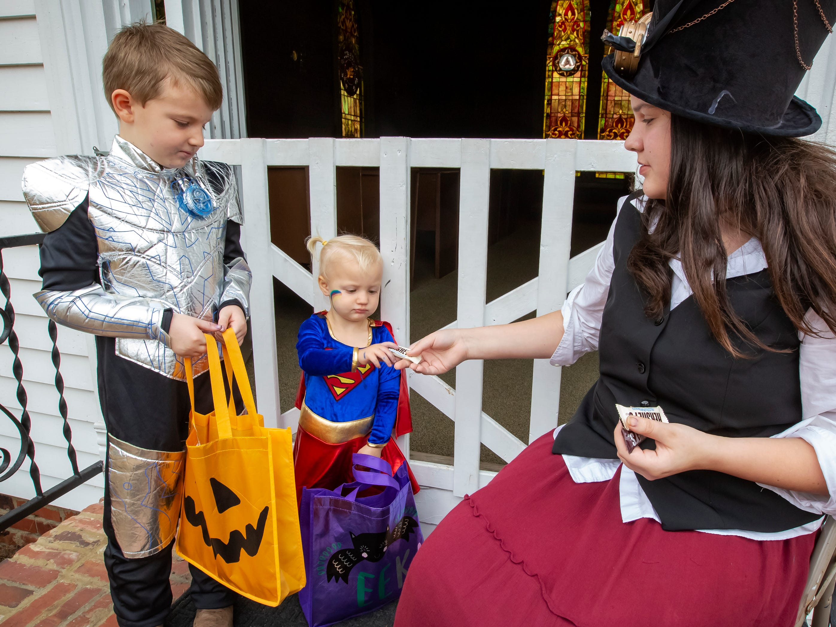 Cora Hazel and Cabe Toombs get treats at the Fall Celebration and Hayride at Cannonsburgh Village.