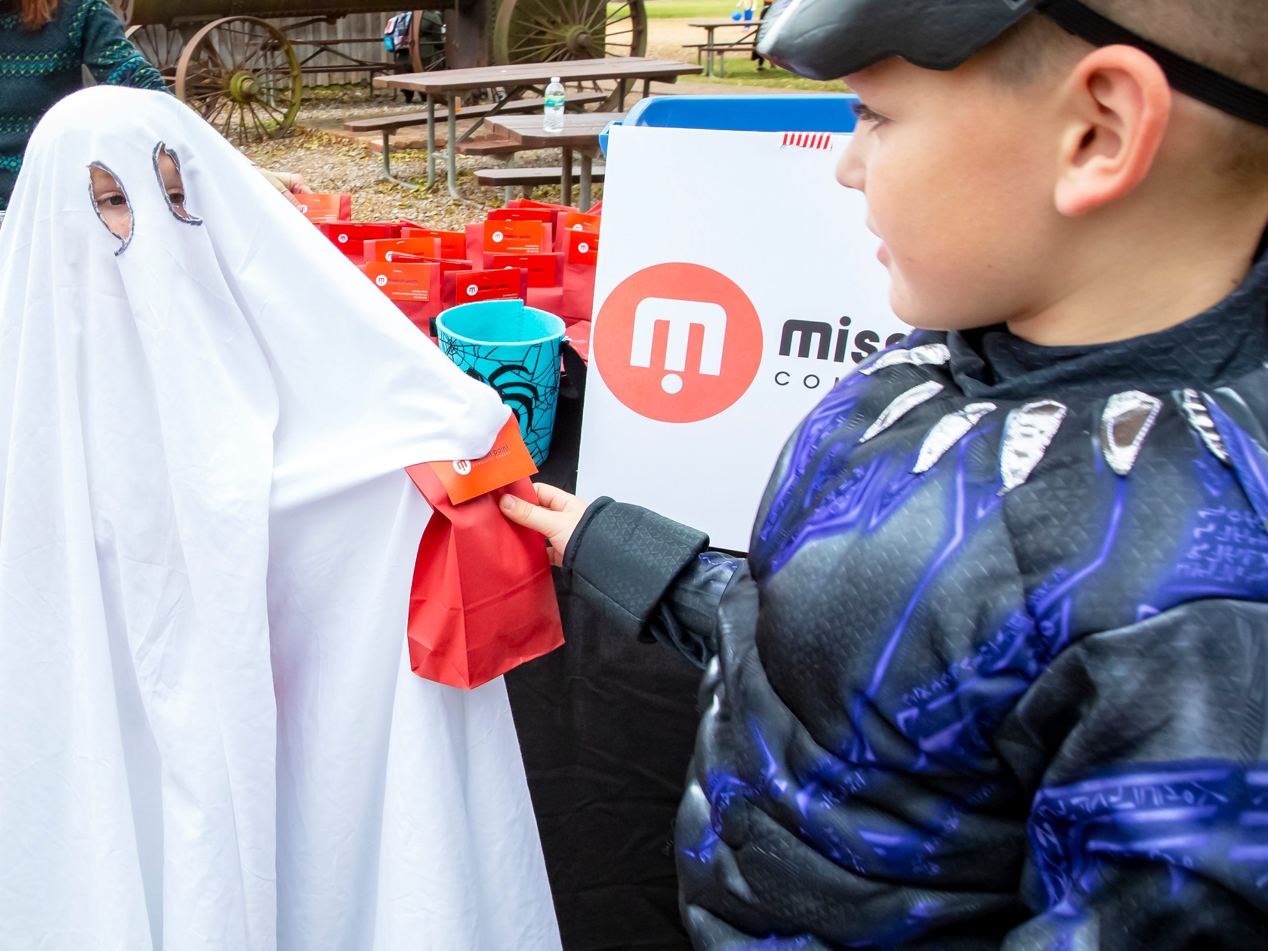 Gwyn Miles dressed as Casper the Ghost passed out bags of treats at the Fall Celebration and Hayride at Cannonsburgh Village.