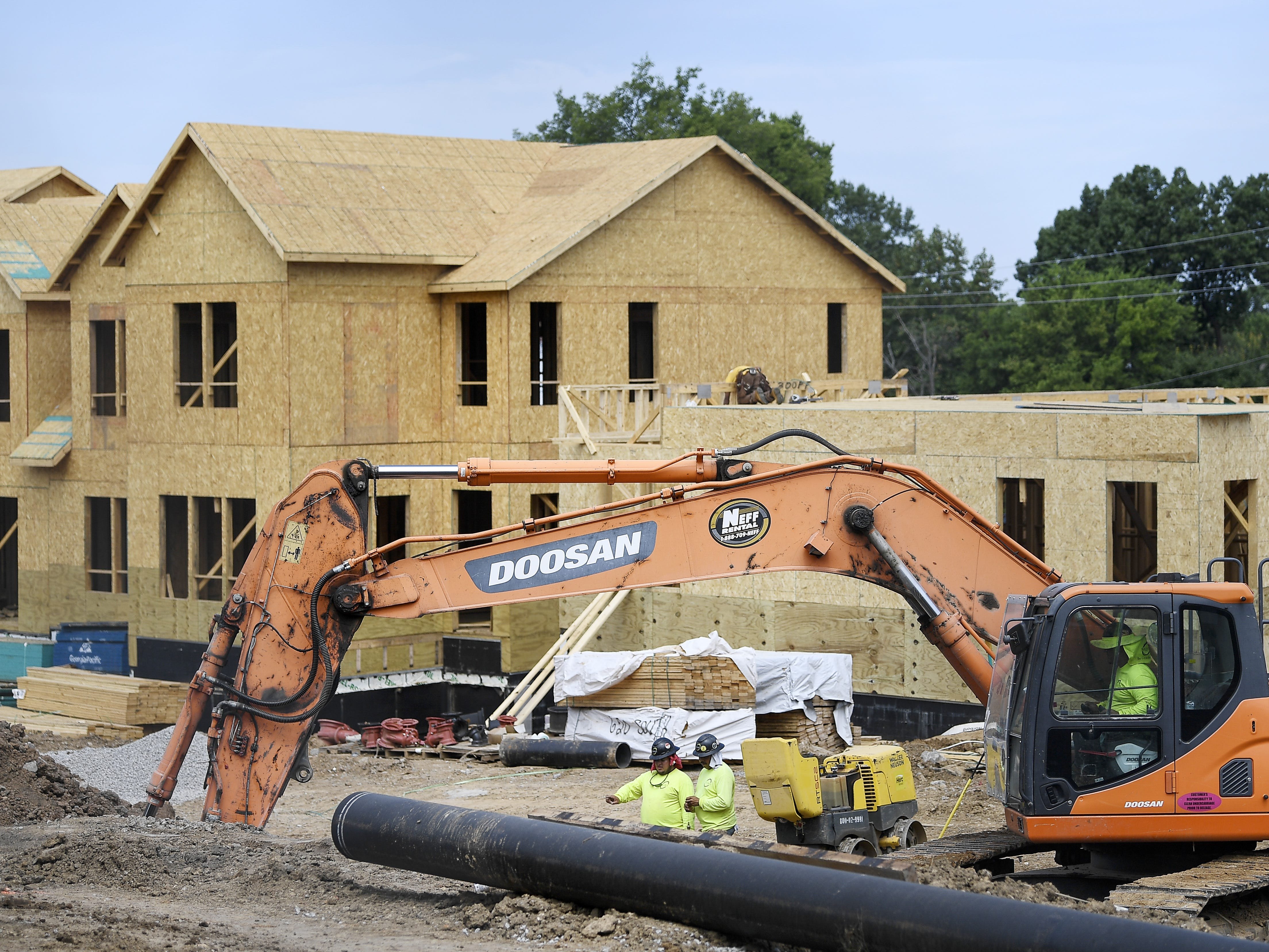 Construction workers build housing at the James A. Cayce Homes for a new MDHA project called Envision Cayce on July 18, 2018.
