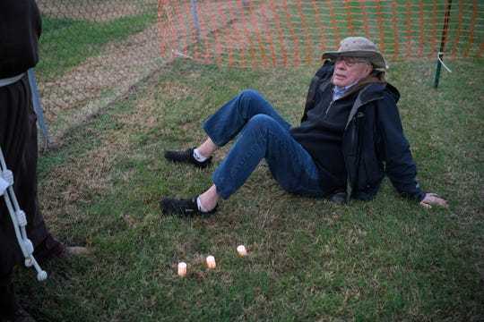 Michael Passino sits with candles before the execution of Edmund Zagorski outside Riverbend Maximum Security Institution Thursday.