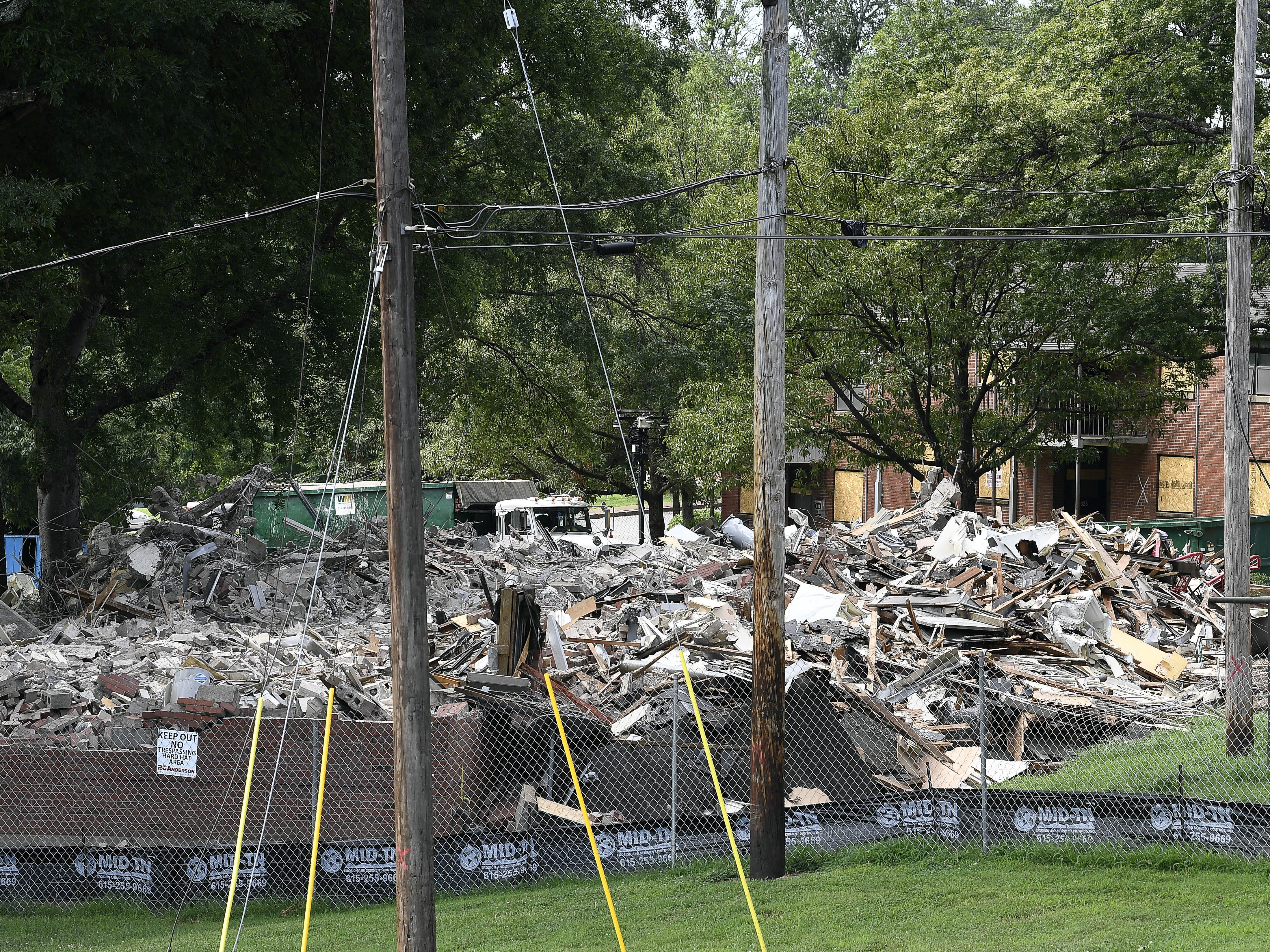 Construction workers demolish old public housing at the James A. Cayce Homes on July 18, 2018, on a site proposed for a new charter school to be run by the Martha O'Bryan Center.