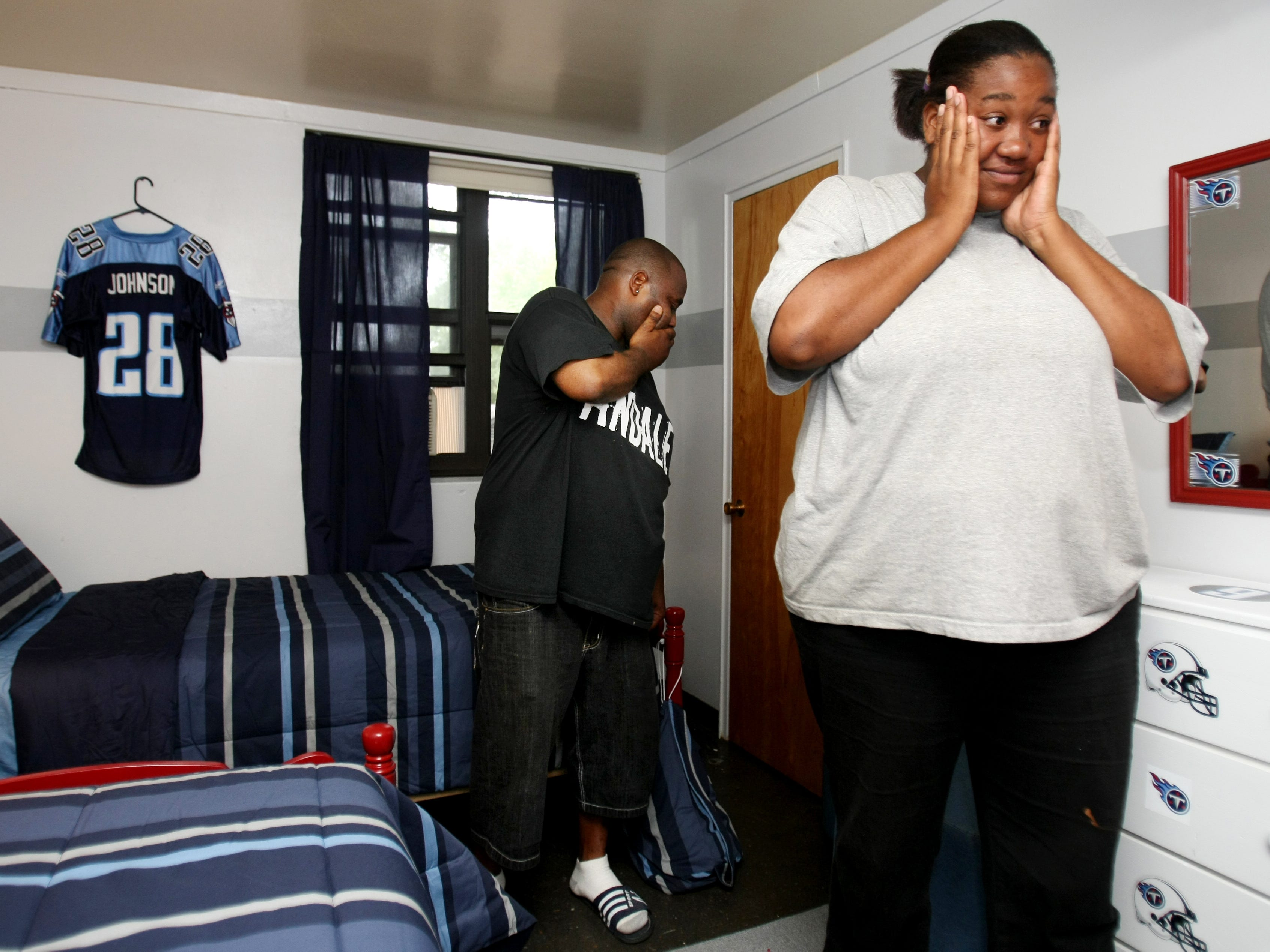 James A. Cayce Homes resident Tara Malone, right, 27, is surprised after seeing her sons' newly designed bedroom Sept. 26, 2009. Project Redesign is a program that provides furniture for families in immediate crisis and does room redesigns for needy families. The organization's primary focus is the James A. Cayce Homes, Nashville's largest and most at-risk public housing development.