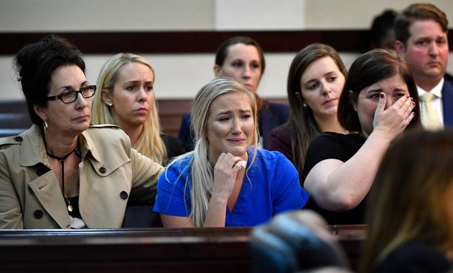 Friends and family of Tiffany Ferguson cry Thursday as the judge sentences Ferguson's killer, Christopher McLawhorn, to life in prison.